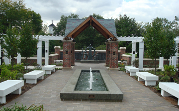 Corboy Gardens with fountain, statue and white benches.