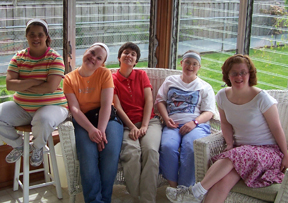 5 young ladies relaxing on back porch at Maxwell CILA