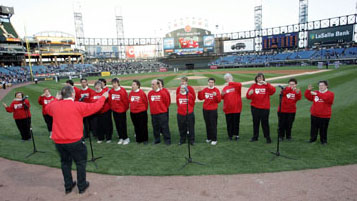 Misericordia Heartzingers dressed in red performing at a White Sox game.